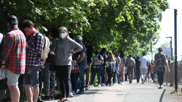 People queuing to go into Belmont Health Centre in Harrow which is offering a first dose of Pfizer coronavirus vaccine to anyone aged over 18 on Saturday and Sunday who is living or working in Harrow. Picture date: Saturday June 5, 2021.