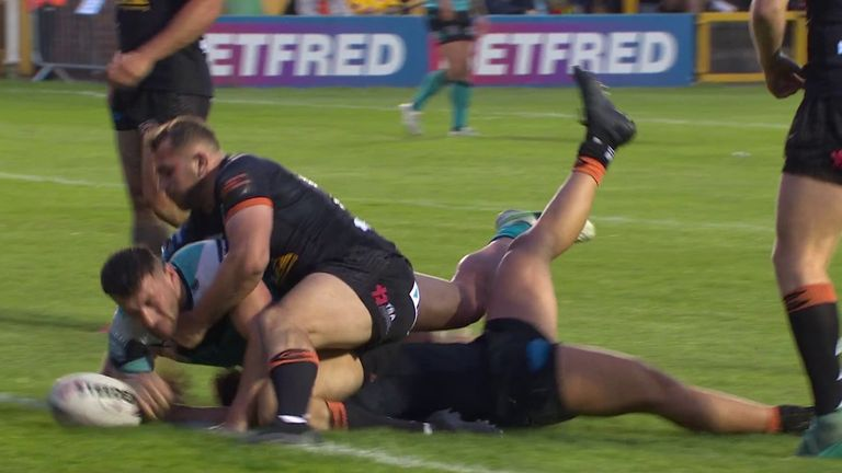 Jake Connor battles over for the Hull FC to put the game out of reach for Castleford
