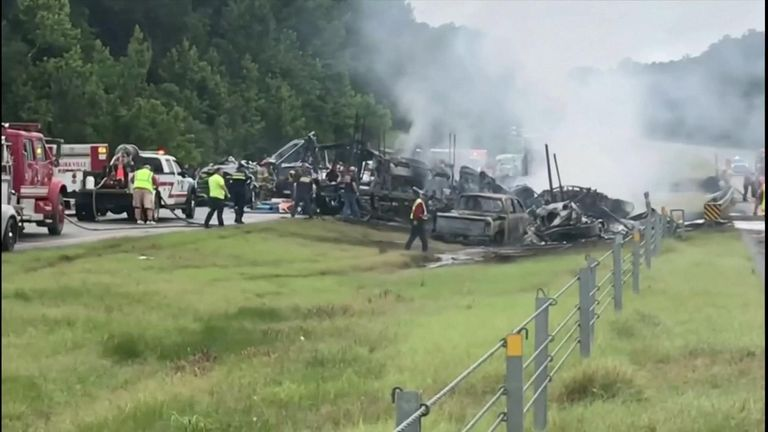 Nine children and a young father were killed when a van and other vehicles slammed together on a rain-drenched Alabama motorway.