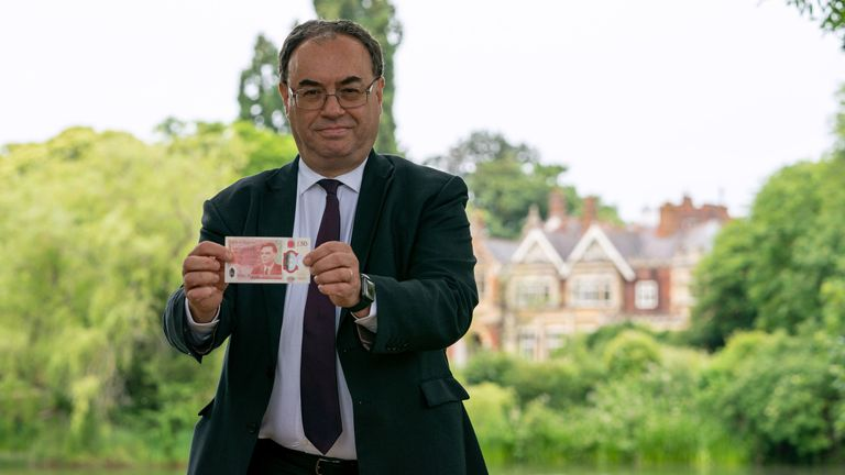 Governor of the Bank of England Andrew Bailey holds up the new £50 note