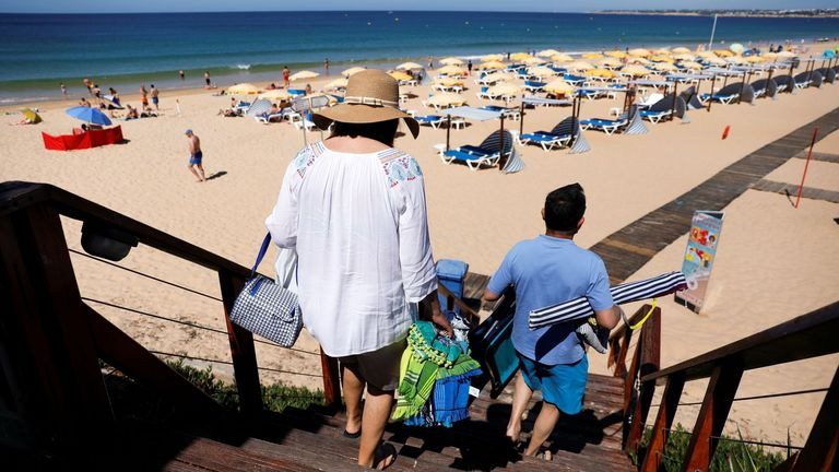People pictured at Gale beach in Albufeira, Portugal