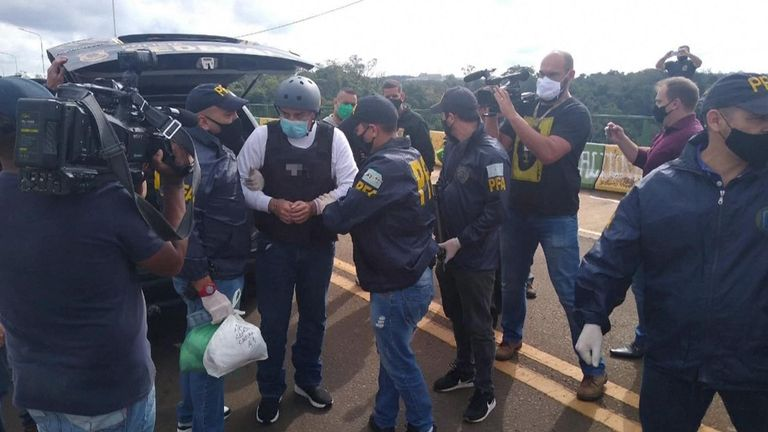 Cabrera in cuffs after arriving back in Argentina