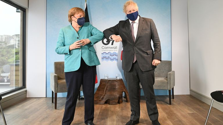 Britain's Prime Minister Boris Johnson and German Chancellor Angela Merkel elbow bump as they attend a bilateral meeting during G7 summit in Carbis Bay, Cornwall, Britain, June 12, 2021. Stefan Rousseau/Pool via REUTERS
