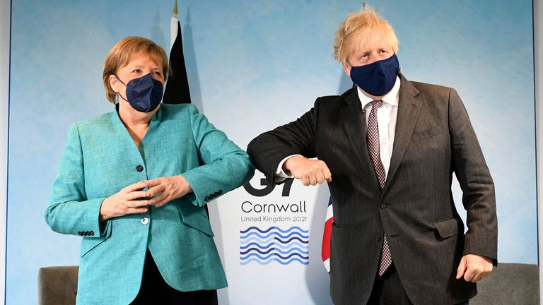 Prime Minister Boris Johnson (right) greets German Chancellor Angela Merkel, ahead of a bilateral meeting during the G7 summit in Cornwall. Picture date: Saturday June 12, 2021. PA Photo. See PA story POLITICS G7. Photo credit should read: Stefan Rousseau/PA Wire