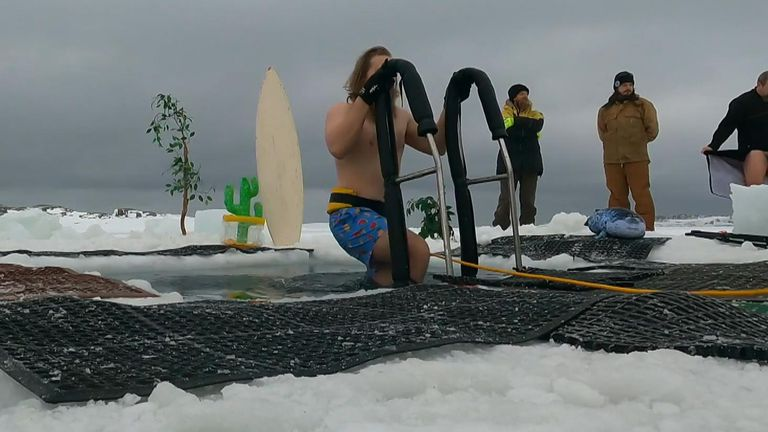 Expeditioners at one of Australia's research bases in Antarctica took a sub-zero polar plunge into icy waters to celebrate the winter solstice.