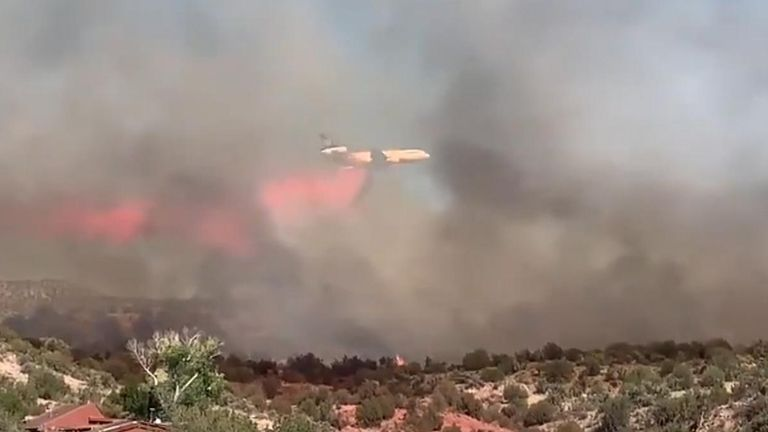 """Evacuation orders were in place on June 13 as a fire near Cornville, Arizona, grew to approximately 1,000 acres.  Officials confirmed one outbuilding had been destroyed, adding that crews were """"actively engaged in providing structure protection."""""""