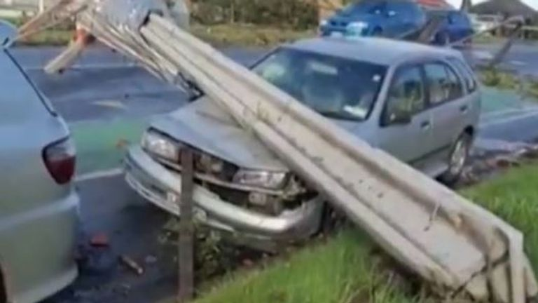 Car is crushed by effects of tornado in Auckland