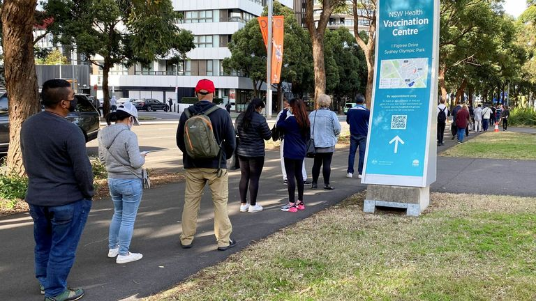 People wait in line outside a vaccination centre at Sydney Olympic Park in Sydney, Australia. Pic: AP