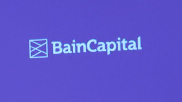 A reporter raises his hand to ask a question during a news conference by Bain Capital LP Managing Director Yuji Sugimoto (not in the picture) in Tokyo, Japan October 5, 2017