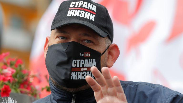Blogger Sergei Tikhanovsky speaks during a rally of opposition supporters in Minsk