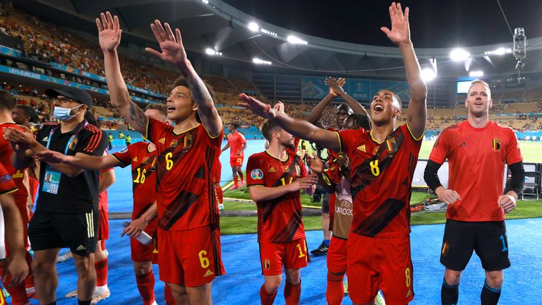 Belgium players celebrate after defeating Portugal