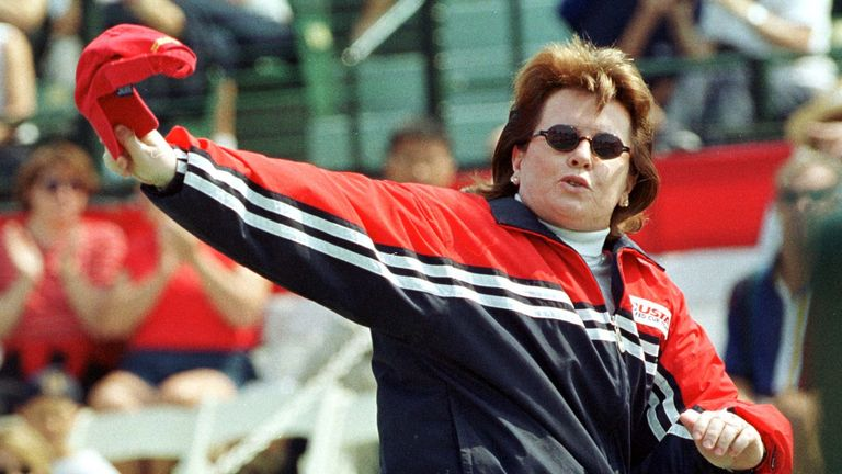 Tennis legend Billy Jean King, who is coaching the United States tennis team at this event, waves her hat as she walks onto the court during the 1999 World Group Final of the Fed Cup at Taube Family Tennis Stadium at Stanford University in Palo Alto, September 18.