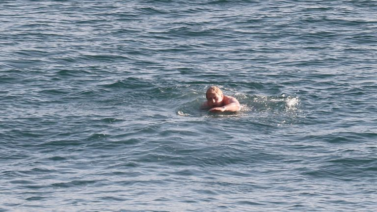 Boris Johnson starts the day with refreshing swim in Carbis Bay. Pic: Getty