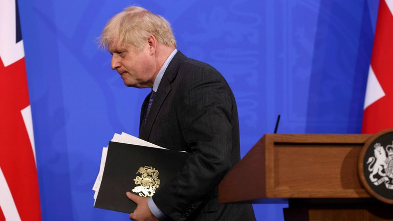 Boris Johnson leaves the media briefing where he announced a delay in the easing of lockdown in England