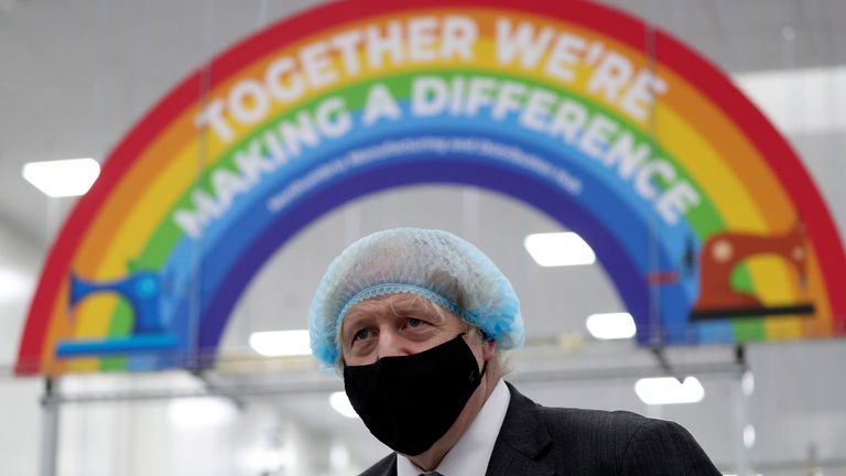 Boris Johnson, seen at a PPE plant, has delayed the easing of lockdown, but does the data back that up?