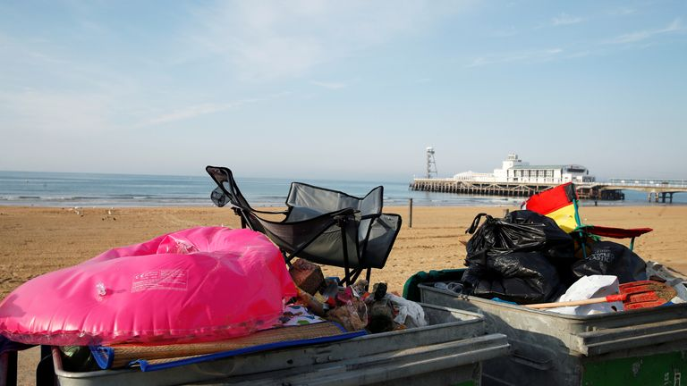 Disposal bins are seen filled with litter on Bournemouth beach, as the outbreak of the coronavirus disease (COVID-19) continues in Bournemouth