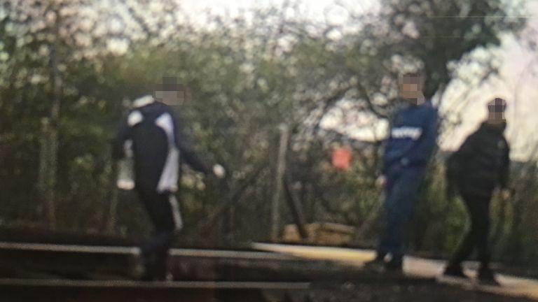 CCTV images show boys walking on a train track in Bewbush near Crawley. Pic: Network Rail