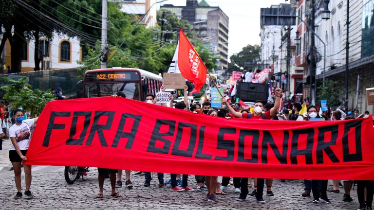 'Bolsonaro out', one banner read, while others accused him of genocide. Pic: AP