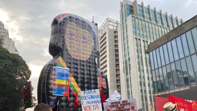 Marchers on the streets of Sao Paulo have been carrying signs reading 'Bolsonaro out!'