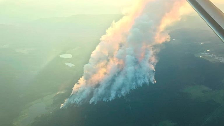 Smoke billows at Thompson-Nicola Regional District in British Columbia during the Sparks Lake wildfire