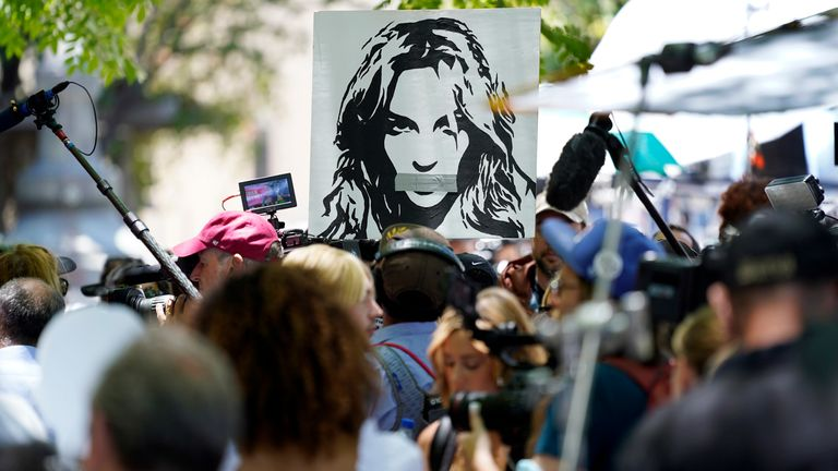 A portrait of Britney Spears looms over supporters and media members outside a court hearing concerning the pop singer's conservatorship in Los Angeles. Pic: AP
