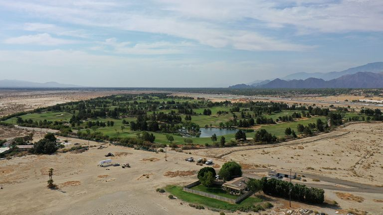 Aerial view of a golf course next to desert landscape as the state faces its worst drought since 1977, in Palm Desert, California, U.S., June 29, 2021. Picture taken with a drone June 29, 2021. REUTERS/Aude Guerrucci TEMPLATE OUT
