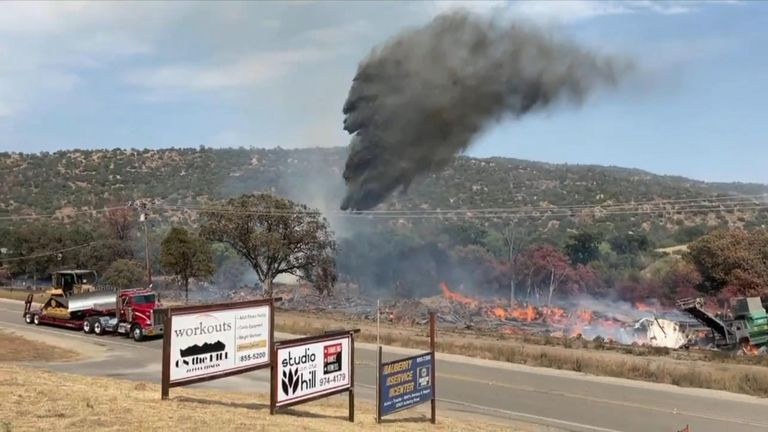 A fire burning at a lumber mill in Auberry, California, on Wednesday, June 16, threatened structures and prompted evacuations for nearby residents.