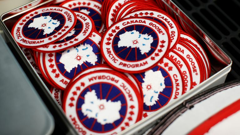 Patches with the Canada Goose logo are stacked in the Canada Goose factory in Toronto