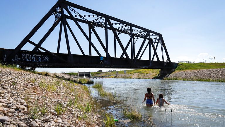 People cool down in a canal in Alta, Canada. Pic: AP
