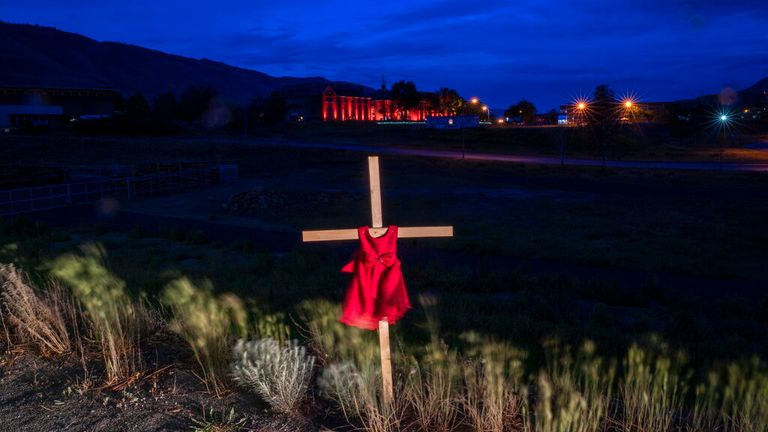 A cross outside the former school where the remains of 215 children were found in Saskatchewan (Pic: AP)