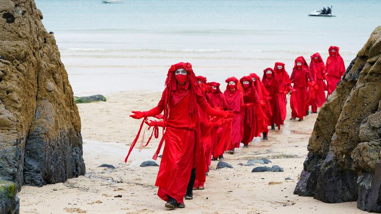 Climate protesters march along Carbis Bay near St Ives