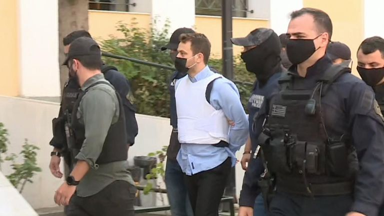 Caroline Crouch's husband Babis Anagnostopoulos arrives at court flanked by armed police and wearing a flak jacket.