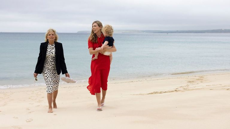Carrie Johnson carries son Wilfred as they are pictured on the beach with Jill Biden in Carbis Bay, Cornwall. Pic: Flickr/Simon Dawson/No 10 Downing Street