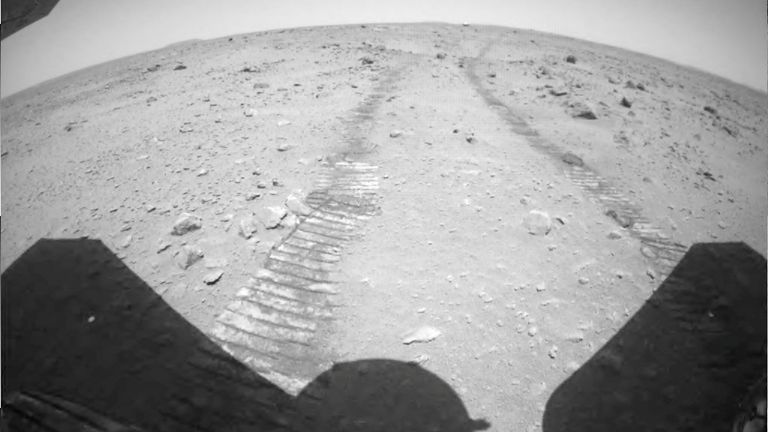Ruts on the surface of Mars are seen from the rear of the Chinese rover Zhurong