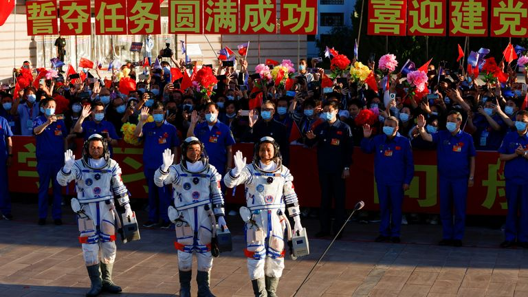 Chinese astronauts Tang Hongbo, Nie Haisheng and Liu Boming wave before the launch of the Long March-2F Y12 rocket, carrying the Shenzhou-12 spacecraft and the three astronauts, from Jiuquan Satellite Launch Center for China's first manned mission to build its space station, near Jiuquan, Gansu province, China June 17, 2021. REUTERS/Carlos Garcia Rawlins