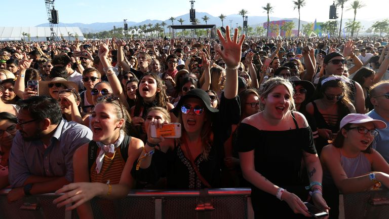 People dance while the band Bastille, performs during the Coachella Valley Music and Arts Festival in Indio, California, U.S. April 15, 2017. REUTERS/Carlo Allegri