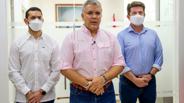 Ivan Duque speaks, flanked by Interior Minster Daniel Palacios, left, and Defense Minister Diego Molano. Pic: AP