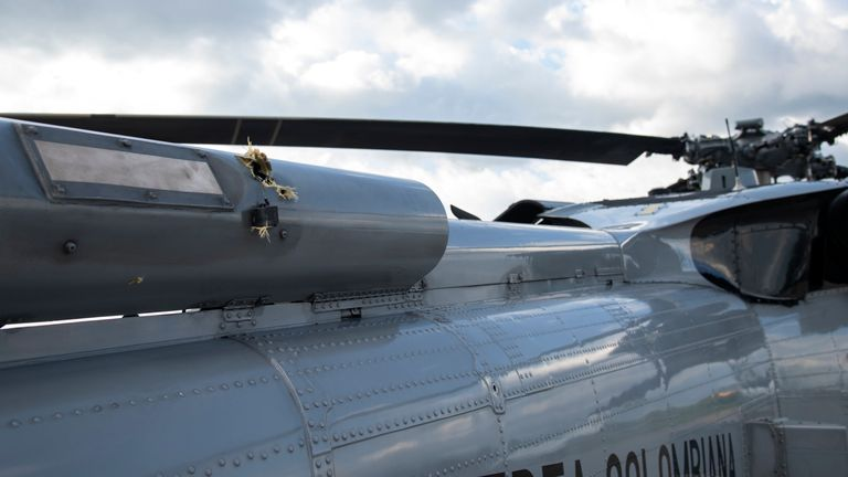 Bullet holes are seen on the fuselage of a Colombian Air Force helicopter. Pic: AP