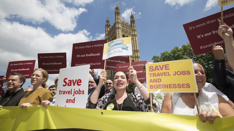 Representatives from tour operators and travel agencies attend the 'Travel Day of Action' demonstration at Westminster to put pressure on government to safely reopen travel