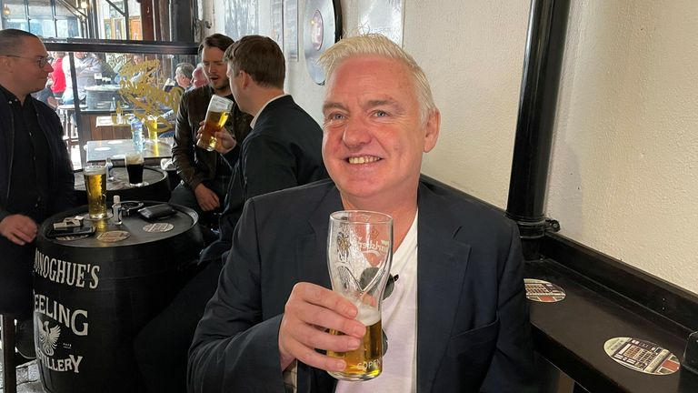 Pat Kelleher enjoys at pint at O'Donoghues which is open for the first time in 15 months