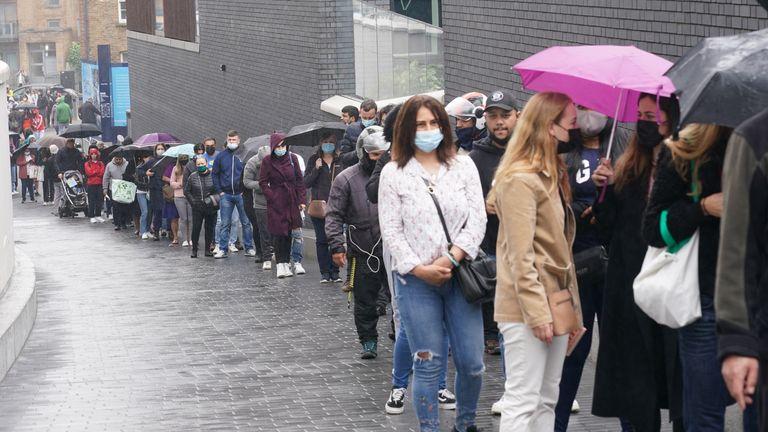 People queue for COVID jabs at Tottenham Hotspur's stadium in north London