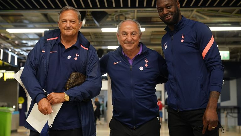 (From left) Ex-Tottenham Hotspur players Gary Mabbutt, Ossie Ardiles and Ledley King post at Tottenham Hotspur's stadium in north London, which is being used as a vaccination clinic