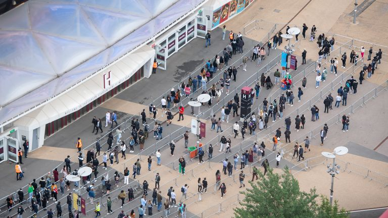 A long line of people queue to be vaccinated at West Ham's London Stadium on Saturday