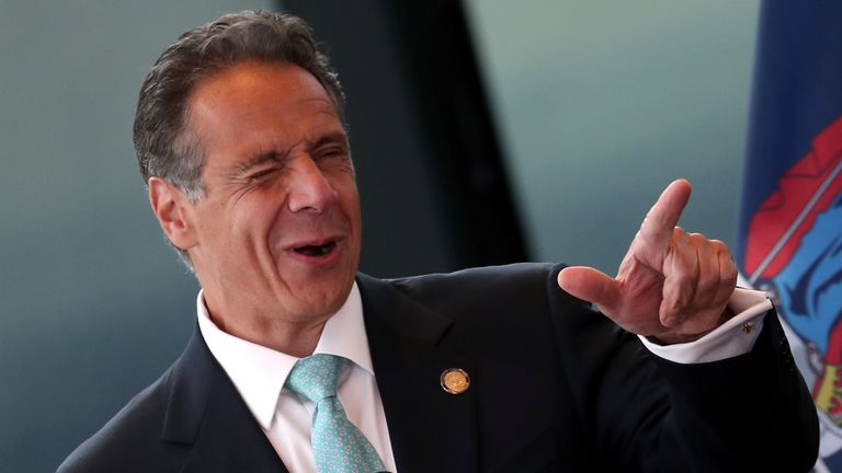 New York Governor Andrew Cuomo winks during his remarks about lifting lockdown rules