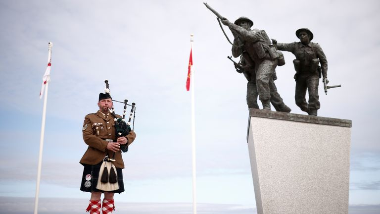 A piper plays before the official opening ceremony of the British Normandy Memorial at Ver-sur-Mer in Normandy