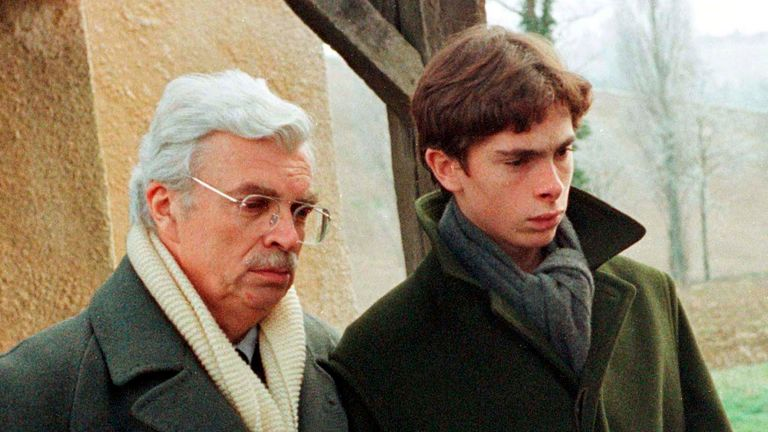 Film producer Daniel Toscan du Plantier (L) attends the funeral of his wife Sophie, with her son Pierre-Louis near Toulouse in 1996