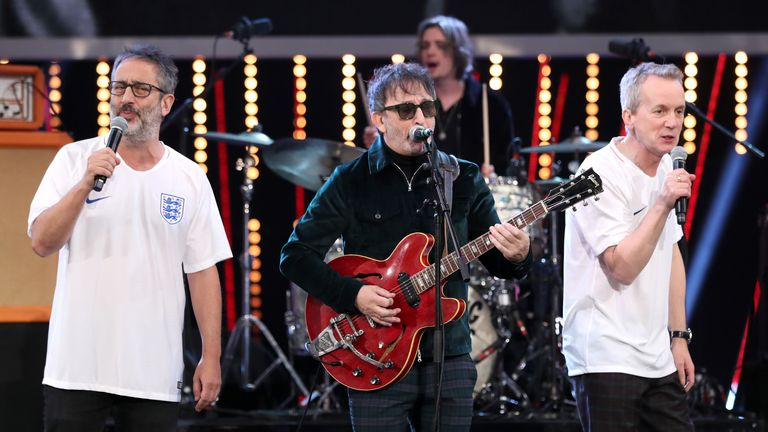 Ian Broudie (centre) of the Lightning Seeds performs with David Baddiel (left) and Frank Skinner