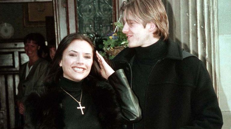 Victoria Adams, a member of the British band The Spice Girls, smiles with her fiancee, Manchester United footballer David Beckham January 25, 1998. Beckham and Adams made their engagement public at a luxury hotel after media speculation over possible venues for their wedding