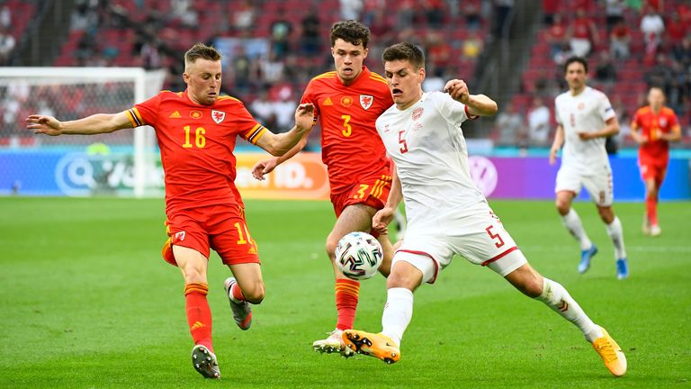 Wales' Joe Morrell and Neco Williams in action with Denmark's Joakim Maehle