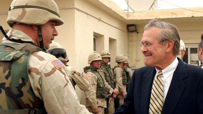 U.S. Secretary of Defence Donald Rumsfeld greets U.S. military personnel during a visit to the Abu Ghraib prison on the outskirts of Baghdad in 2004